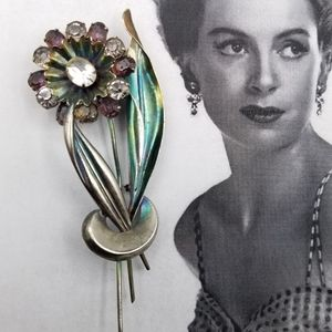 Vintage sterling purple rhinestone flower brooch